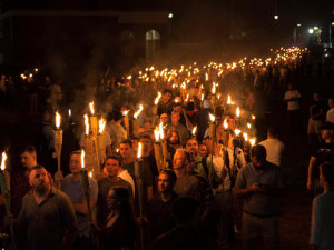 White nationalists carry torches on the grounds of the University of Virginia, on the eve of a planned Unite The Right rally in Charlottesville, Virginia, U.S. August 11, 2017. Picture taken August 11, 2017. Alejandro Alvarez/News2Share via REUTERS. MANDATORY CREDIT. NO RESALES. NO ARCHIVES TPX IMAGES OF THE DAY